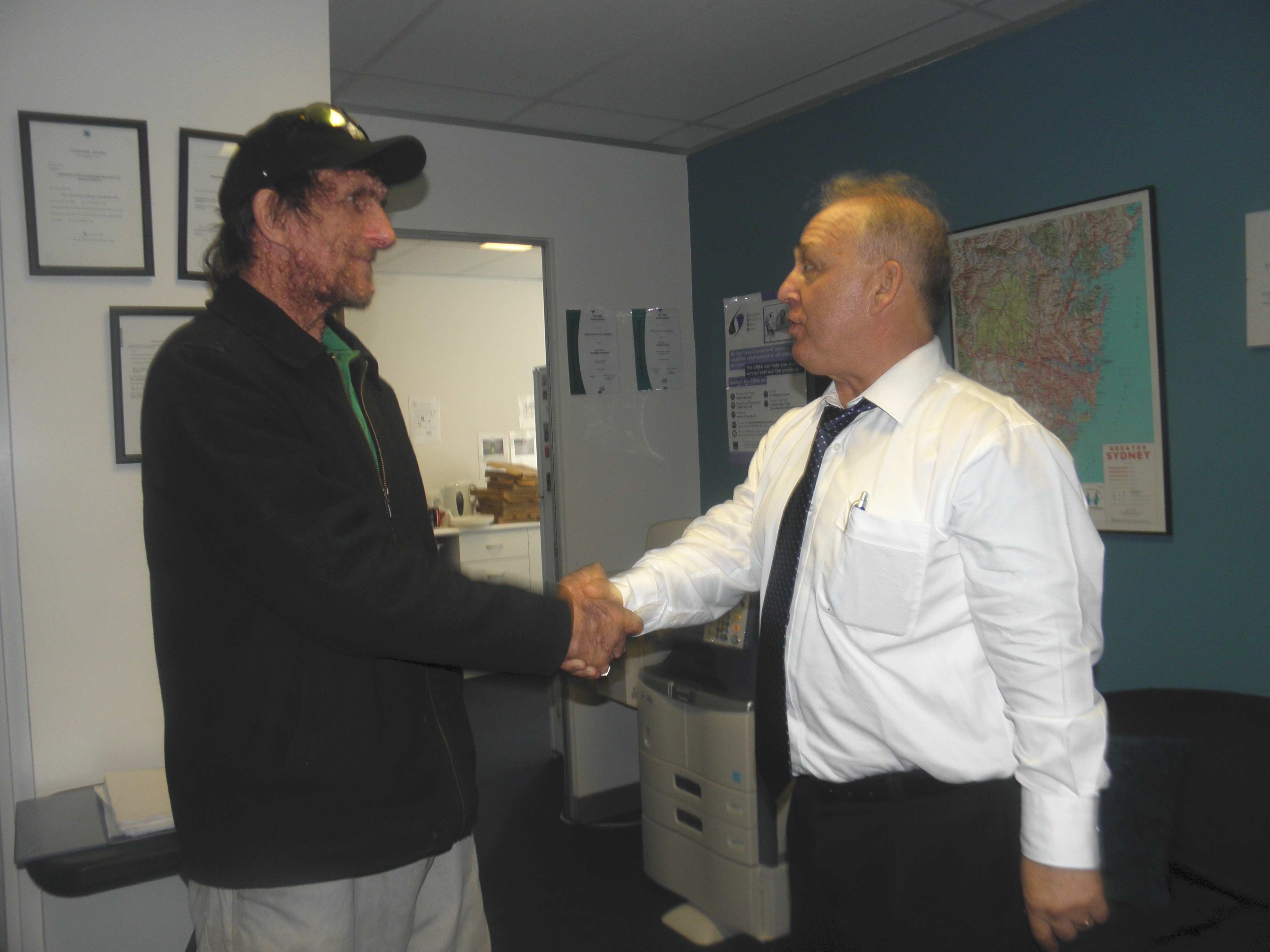 Arthur Bozikas shaking hands with a member