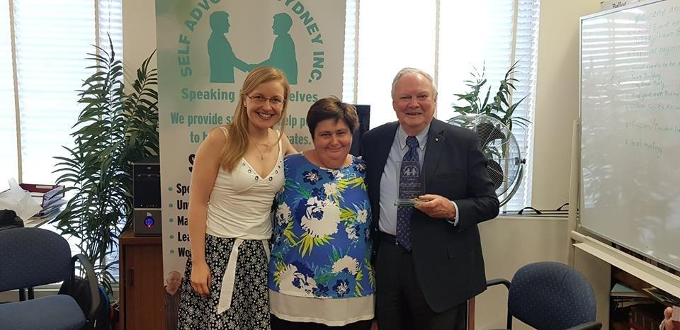 Trevor Parmenter standing next to couple of ladies at event