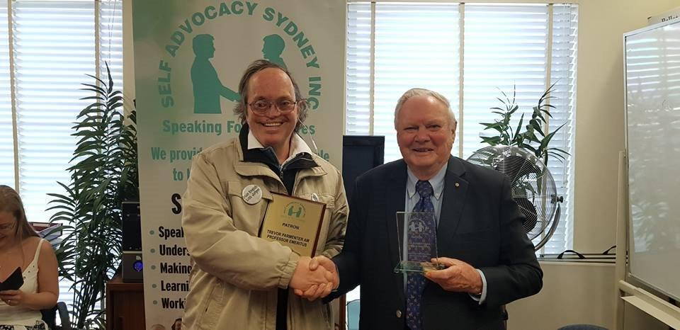Trevor Parmenter shaking man's hand who is holding a certificate
