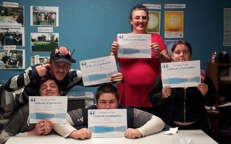 Image of members holding their certificates